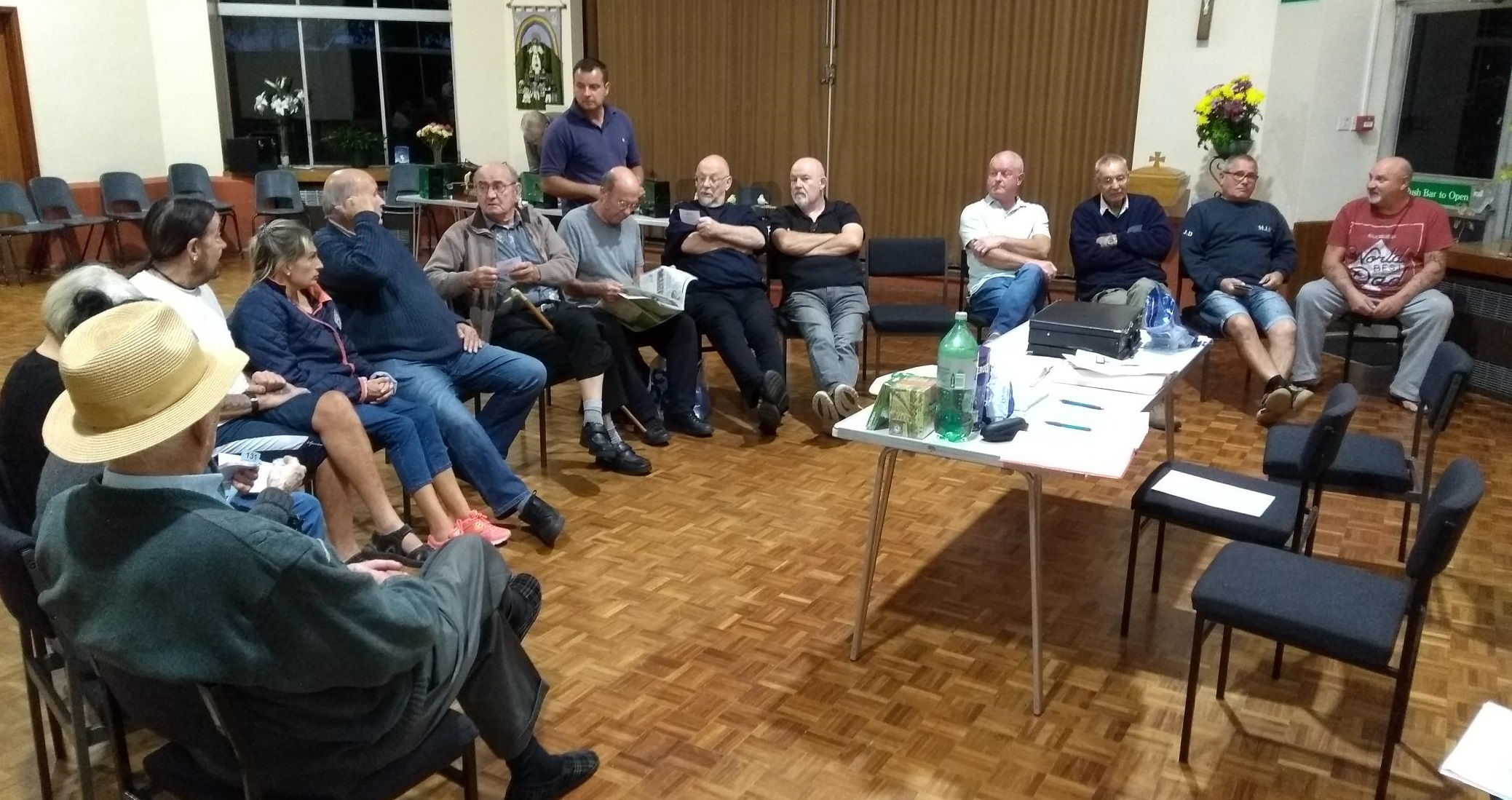 members sat in a semi-circle during the Sept monthly meeting and table show for canaries and British birds